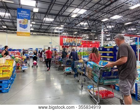 Orlando,fl/usa-3/14/20: Customers Standing In Long Lines Waiting To Check Out Their Groceries At A S