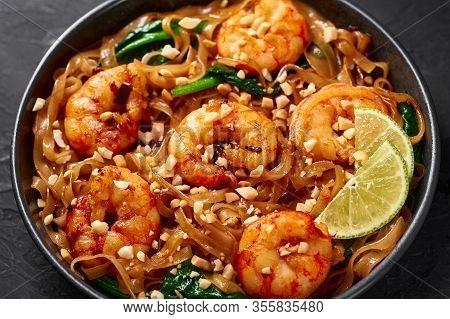 Prawn Pad See Ew In Black Bowl At Dark Slate Background. Pad See Ew Is Thai Cuisine Dish With Rice N