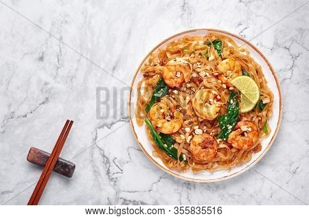 Prawn Pad See Ew On White Marble Background. Pad See Ew Is Thai Cuisine Dish With Rice Noodles, Praw
