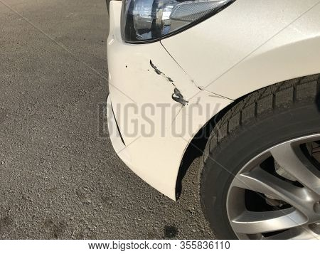 Dent car scratch close-up. Crashed car in accident
