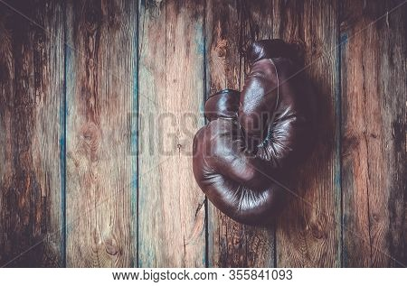 Retro Leather Boxing Gloves On A Wooden Background