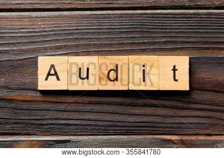 Audit Word Written On Wood Block. Audit Text On Table, Concept