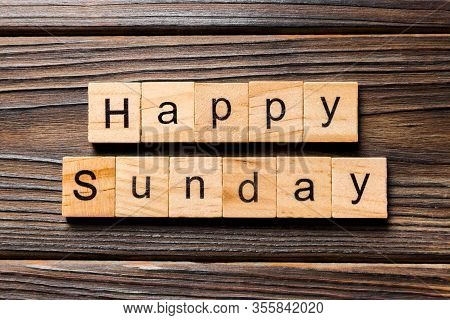 Happy Sunday Word Written On Wood Block. Happy Sunday Text On Wooden Table For Your Desing, Concept