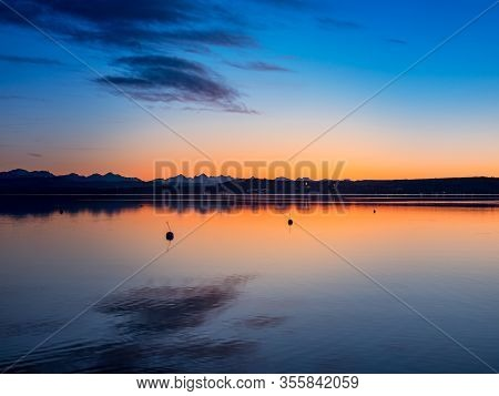 A Beautiful Sunset At Lake Ammer With View To The Alps, Bavaria, Germany
