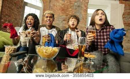 Indoors. Excited People Watching Sport Match, Chsmpionship At Home. Multiethnic Group Of Friend, Fan