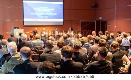 Round Table Discussion At Business Conference Event.