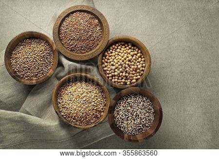 Various Of Healthy Seeds And Cereals - Flax Seed, Chia Seeds, Soybean, Buckwheat And Oats. Copy Spac