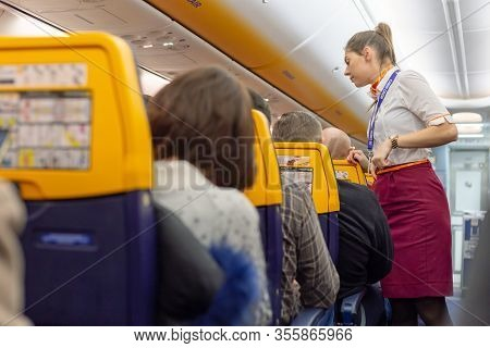 Gdansk Poland Paris France 12 19 2019 Flight. Stewardess And Passengers In Airplane Cabin Airline Ra