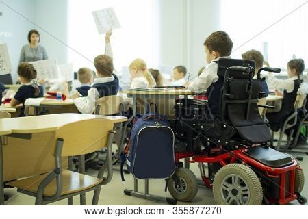 A Disabled Student In A Wheelchair In Primary School.