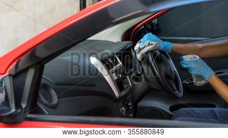 Cleansing Car Interior And Spraying With Disinfection Liquid. Hands In Rubber Protective Glove Disin
