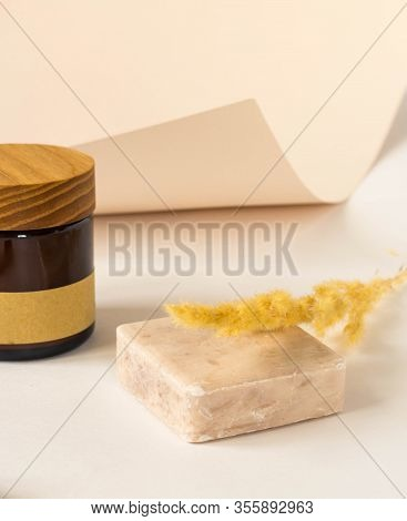 Handmade Bar Of Soap, Pumice Stone And Washcloth. Olive Soap, Facecloth And Pumice Stone On Wooden B