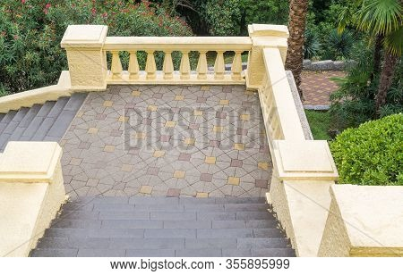 Stone Old Staircase With Parapet In Tropical Park. The View From Top