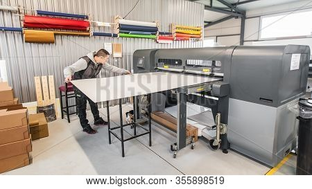 Technician Operator Works On Large Premium Industrial Printer Plotter Machine
