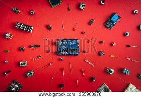 Sankt-petersburg, Russia - February 28, 2020: Arduino Uno Board Over Red Background. Microcontroller