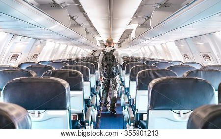 Inside View Of Commercial Airplane With Lonely Man Traveler - Emergency Travel Concept About Flight