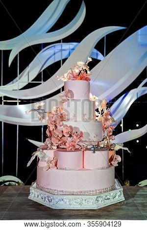 Multi-tiered Pink Wedding Cake Adorned With Sugar Flowers And Birds