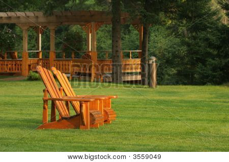 Pair Of Muskoka Chairs On Lawn