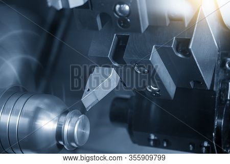 The Cnc Lathe Machine In Metal Working Process Forming Cutting The Metal Shaft Parts With In The Lig