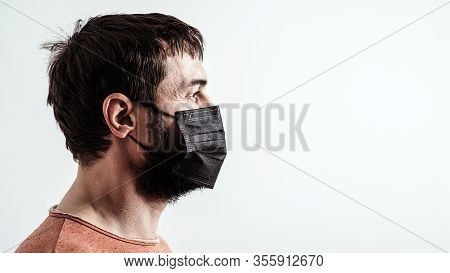 Coronavirus Epidemic. Man With Medical Face Mask For Protect Against Infection With Influenza Virus