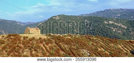 Old Abandoned House Made Of Big Stones Above The Hill And The Wild And Desolate Landscape Without Pe