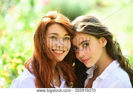 Sisters Having Fun Outdoor. Cute Positive Portrait Of Best Friend Pretty Young Girls, Spring Time, H