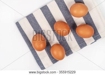 Chicken Raw Eggs On The Kitchen Dishcloth