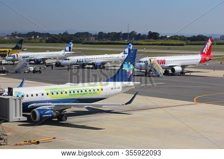 Curitiba, Brazil - October 9, 2014: Tam Airlines Airbus A320 And Azul Airlines Embraer E190 At Curit