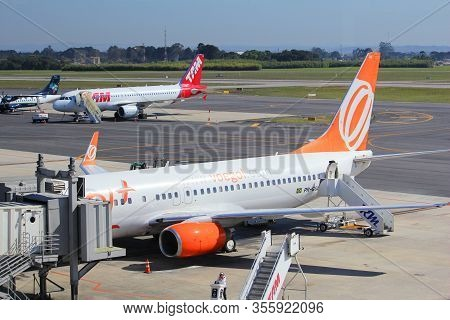 Curitiba, Brazil - October 9, 2014: Tam Airlines Airbus A320 And Gol Airlines Boeing 737 At Curitiba