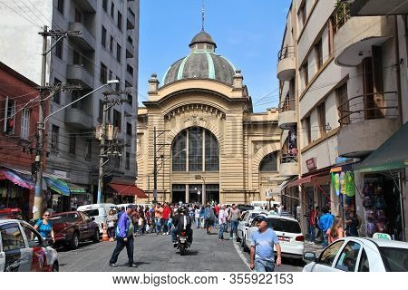 Sao Paulo, Brazil - October 6, 2014: People Visit Municipal Market In Sao Paulo. With 21.2 Million P