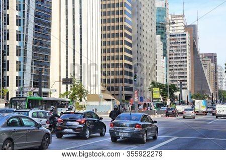 Sao Paulo, Brazil - October 6, 2014: Cars Drive At Avenida Paulista Avenue, Sao Paulo. With 21.2 Mil