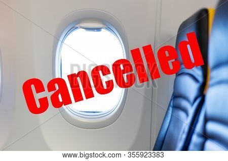 Flight Cancelled. Coronavirus, Red Warning Sign With Text Cancelled Flight In Empty Airplane Cabin.
