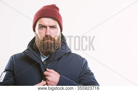 Hipster Outfit. Man Bearded Hipster Stand In Warm Black Jacket Parka Isolated On White. Stylish And