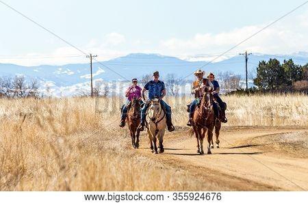 Brighton, Colorado - March 8, 2020: Horseback Riders Take Advantage Of The Nature Trails Available A