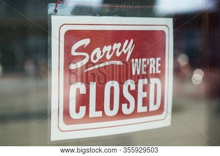 Sorry Were Closed Sign Behind Dirty Glass Door During Corona Lockdown