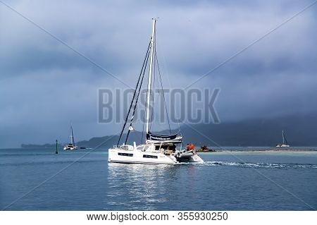 French Polynesia, Papeete, December, 27, 2017 - Several Catamarans Getting Ready For The Storm Near