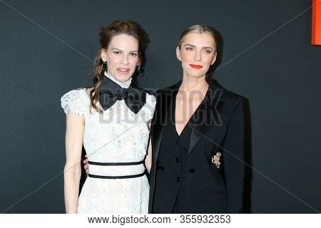 LOS ANGELES - MAR 9:  Hilary Swank, Betty Gilpin at the