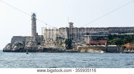 Havana, Cuba - 25 July 2018: El Morro Castle And Lighthouse Taken From Malecon Road In Havana Cuba.