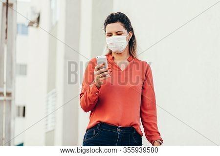 Brazilian Woman Wearing Face Mask Because Coronavirus Pandemic In The City. Covid-19