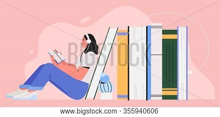 Girl Sitting Near Pile Of Books With Headphones And Listen Them Online. Concept Of Online Reading Or