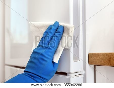 Disinfection In Public Places, The Fight Against The Virus, Coronavirus. The Working Hand Wipes The