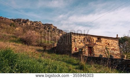 Stone House On The Side Of A Mountain In The Village Of Patones De Arriba, Madrid , Spain. Travel Co
