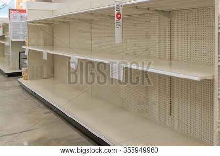 Empty Food Shelves In Supermarket Amidst Covid-19 Concerns.