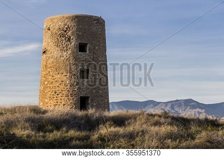 View Of A Tower Of Perdigal, Almeria Distric, Old Fort Tower On The Coast, Almeria, Spain