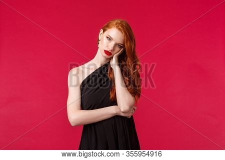 Portrait Of Annoyed And Bored Reluctant Young Redhead Female In Black Evening Dress, Tired Of People