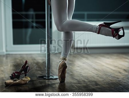 A Girl Dances On A Pylon In One Pointe And One Striptease Shoe. Conceptual Dance Photo