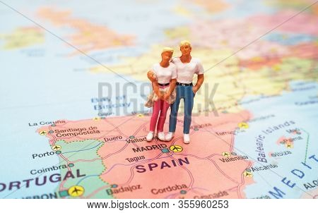 Figures Of The Couple On A Map Of Spain.