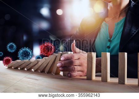 Businesswoman Stops A Chain Fall By Viruses Like Domino Game. Concept Of Preventing Crisis And Failu
