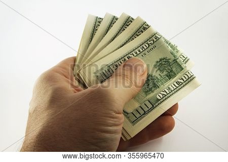 Stack Of American Money In Hand, One Hundred Dollar Cash Banknotes On White Background, Lot Of One H
