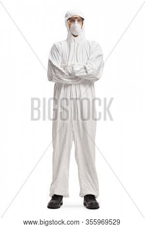Full length portrait of a man wearing a decontamination suit and mask and posing with crossed arms isolated on white background
