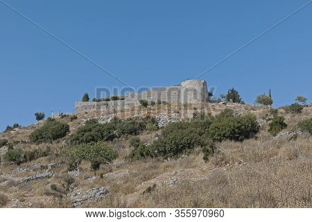 Lekuresi Castle Historical Ruins On A Strategic Hill Point Overlooking The Town Of Sarande Albania,
